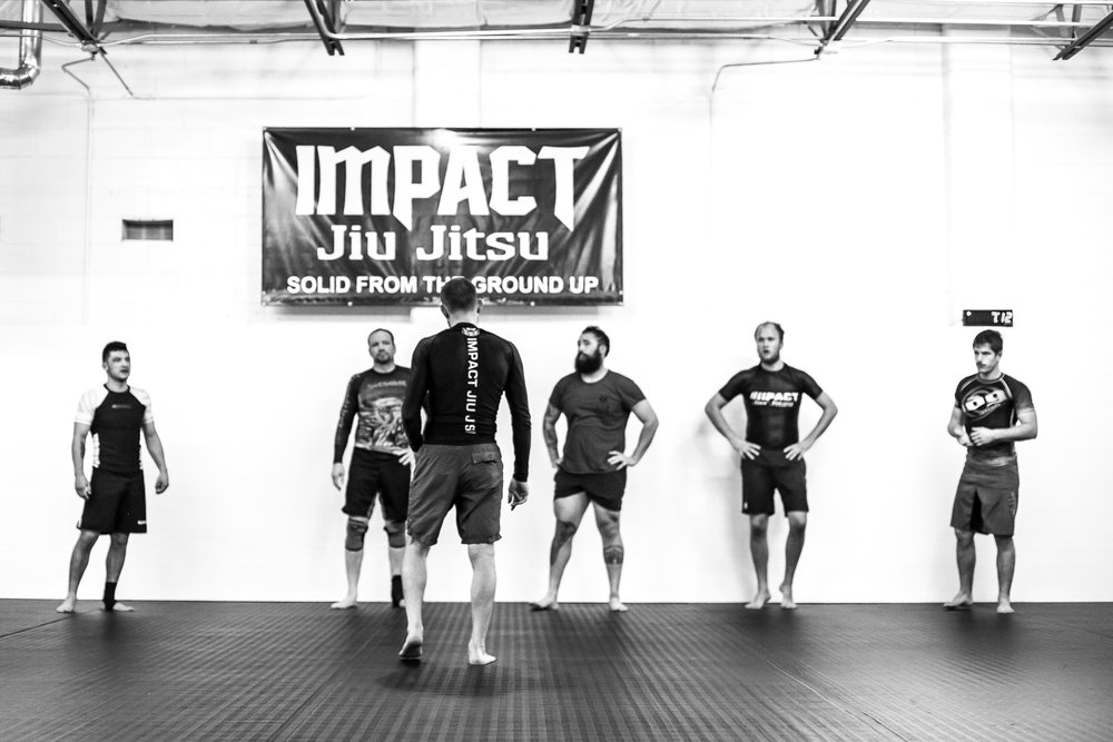 Coach Benjamin Henning teaching a No Gi grappling class at Impact Jiu Jitsu Albuquerque.