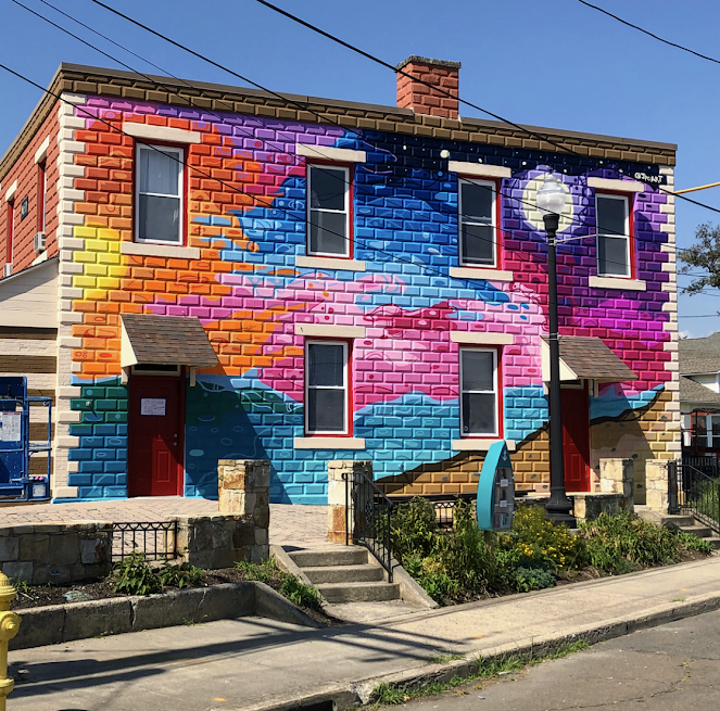 The MAC's Firehouse Gallery, freshly renovated in August 2018. Mural by John Paul O'Grodnick