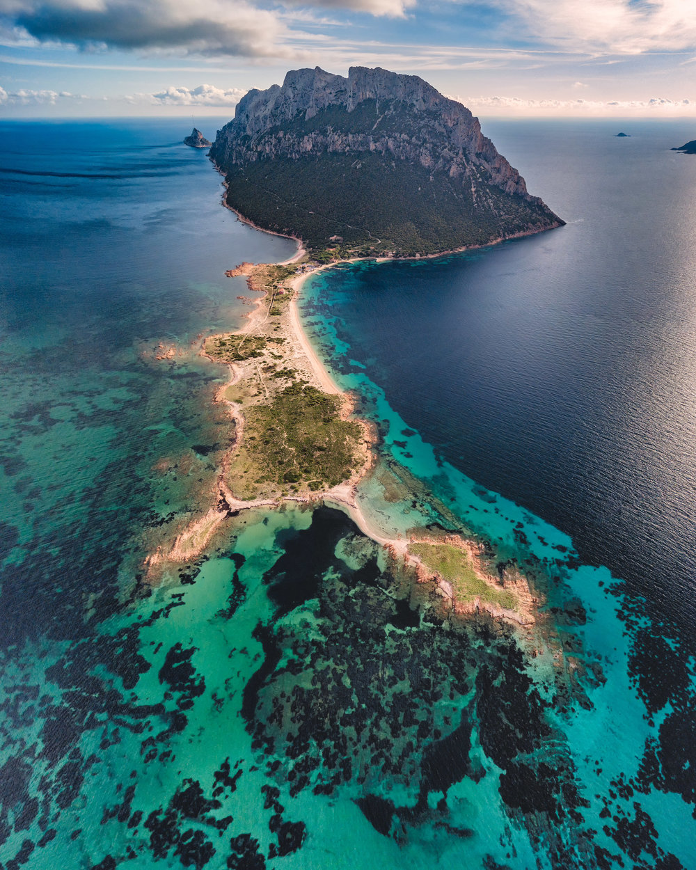 Aerial Photography sessions with drones - The crystal clear water of Sardinia and the colored rocks and cliffs offer an incredible opportunity for aerial photography. Red, white, gray and black rocky formations create a stunning mix of colors and shapes when they encounter the turquoise water of the Mediterranean. During our Sardinia Photo Tours we will have two dedicated sessions with drones to offer you a direct experience with this new discipline that allows to observe and admire our world from an unusual point of view. So many new possibilities to explore from above.