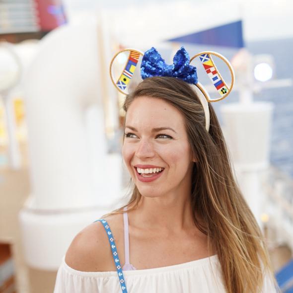 Dana wearing their  Nautical Mouse Ears