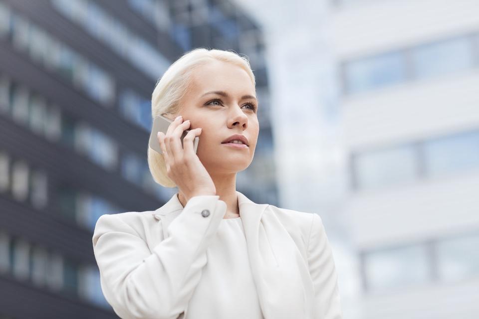 050570347-serious-businesswoman-smartpho.jpeg