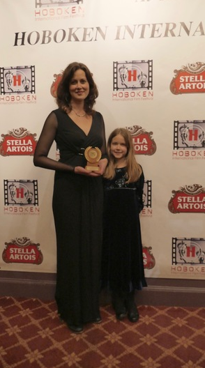 "Kay Rubacek with her daughter and the award for Best Documentary for ""Hard To Believe"" at the Hoboken International Film Festival"