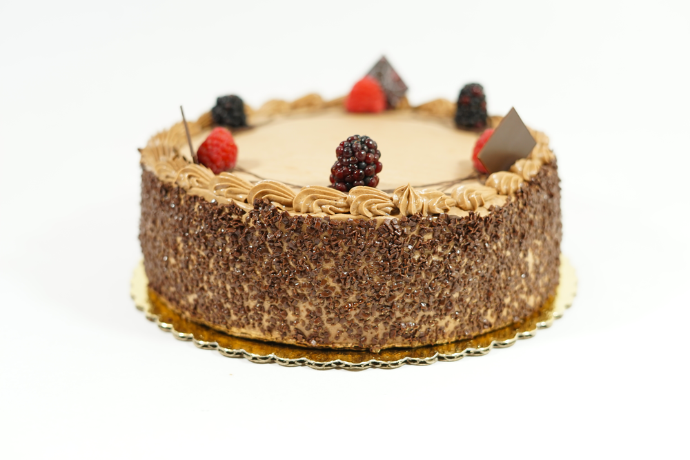 Delice - A chocolate cake with orange liquor syrup and chocolate whipped cream filling. Iced with chocolate buttercream.