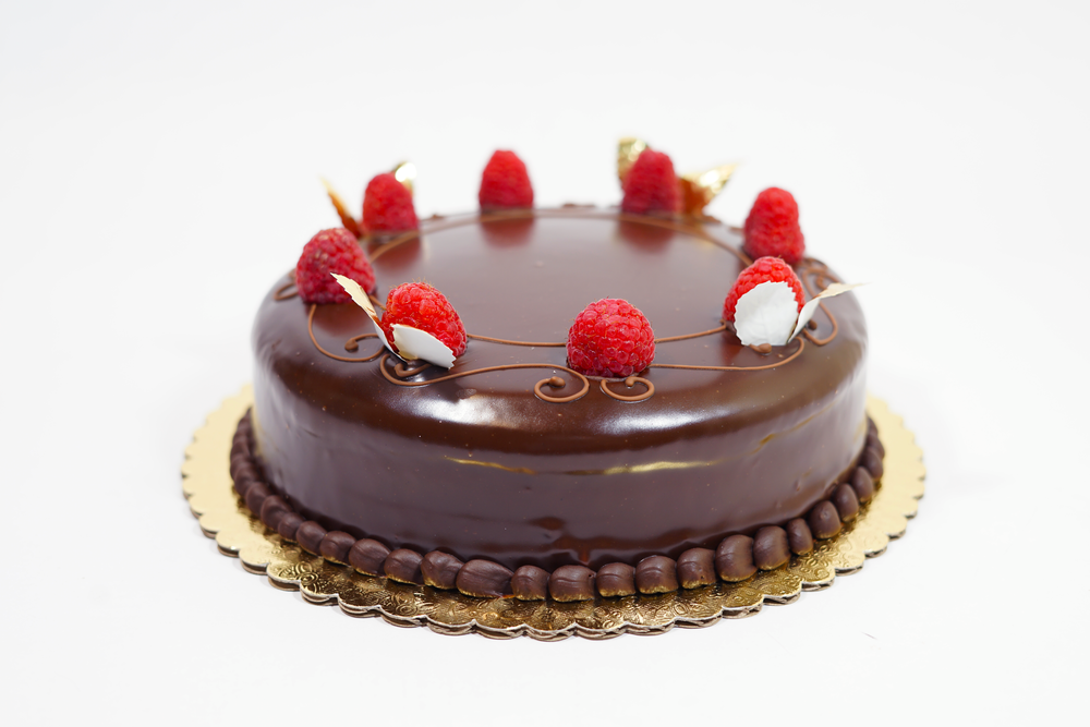Raspberry Truffle - A chocolate cake with raspberry liquor, raspberry jam and chocolate mousse filling. Covered in a ganache glaze.