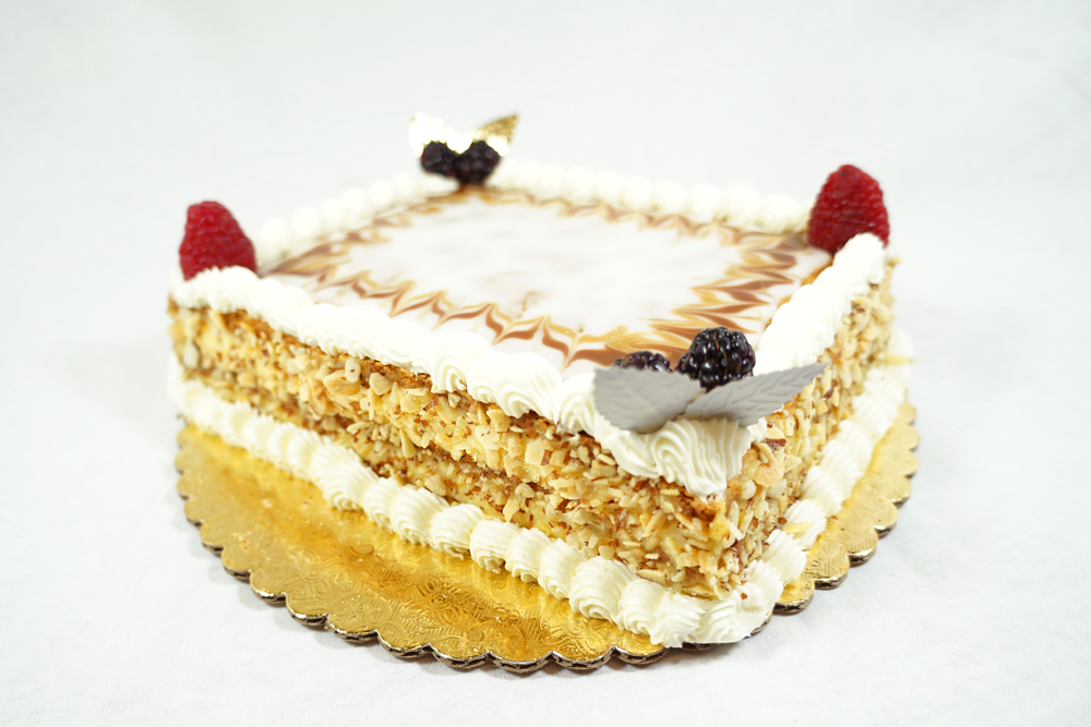 Napoleon - A cake made with layers of puff pastry, Bavarian cream and a fondant sugar top.