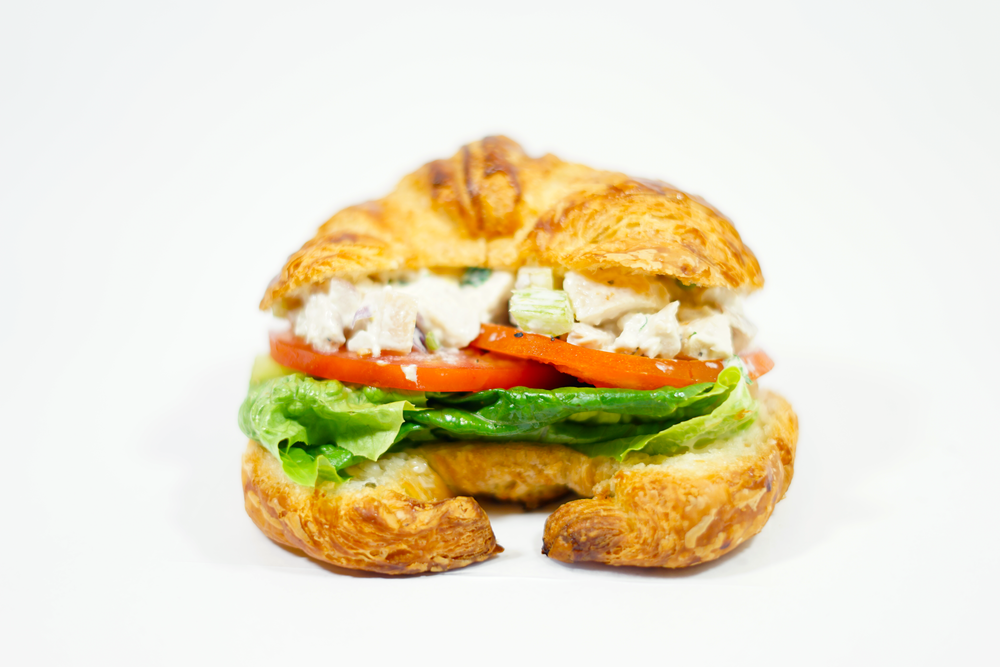 Chicken Salad - On a buttery Croissant with mayo, lettuce, sliced tomatoes, and sprinkle of salt and pepper.
