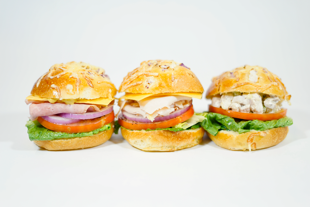 Parker Rolls: Ham, Turkey or Chicken Salad - Ham and Turkey- mayo, cheddar cheese, lettuce, sliced tomatoes and onions, a touch of dijon vinaigrette dressing and sprinkle of salt and pepper. (Ham has Dijon mustard).Chicken Salad- mayo, lettuce, sliced tomatoes, and sprinkle of salt and pepper.