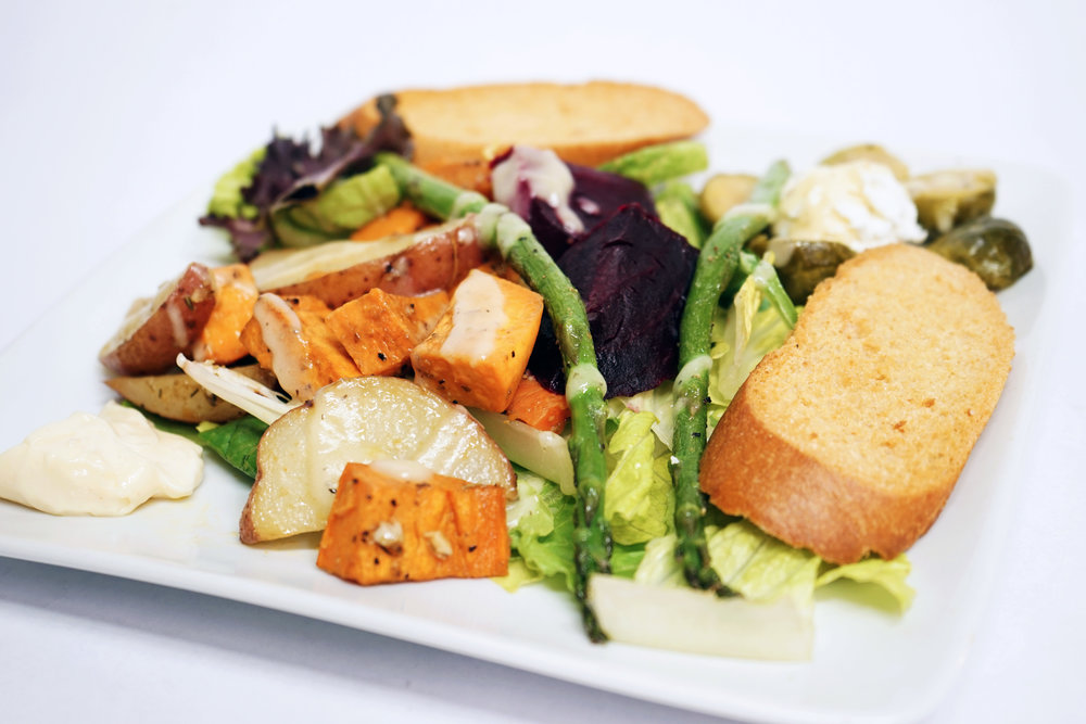Winter:Winter Salad - Roasted winter root vegetables over a bed of mixed greens tossed in a apple vinegrette dressing and garnished with seasonal vegetables and sliced bread toast.
