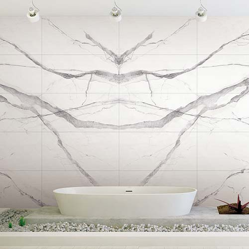 book-match-calacatta-marble-tiled-wall-in-a-designer-white-bathroom.jpg