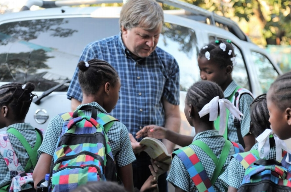 Kids on the way to school get last minute help from John