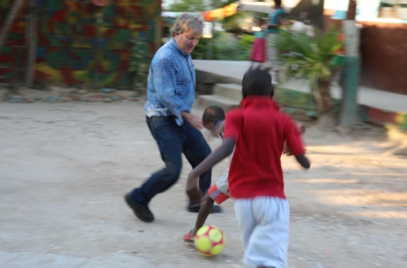 John bought a soccer ball for the kids, and they loved playing with him.