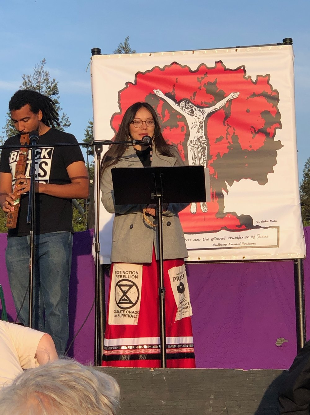 Isabella Ziti from Idle No More, SF Bay Area and Benjamin Mertz give an opening blessing – Honoring the Land and the Ancestors.
