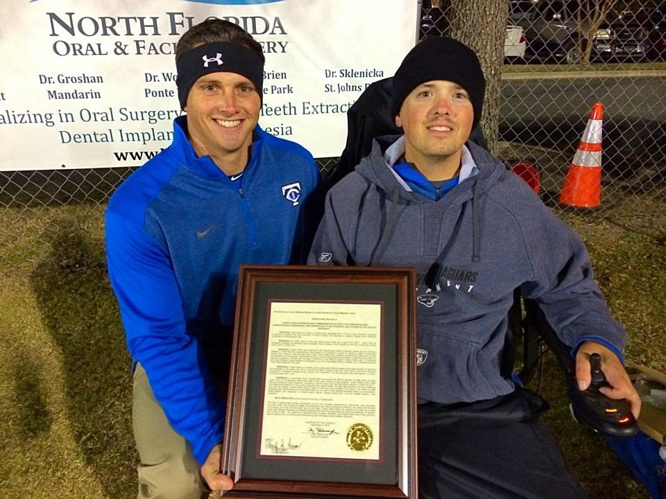 Tim (left) and his Cousin Ryan (right) as Ryan received an award for his contribution impacting young men through coaching football and weightlifting.