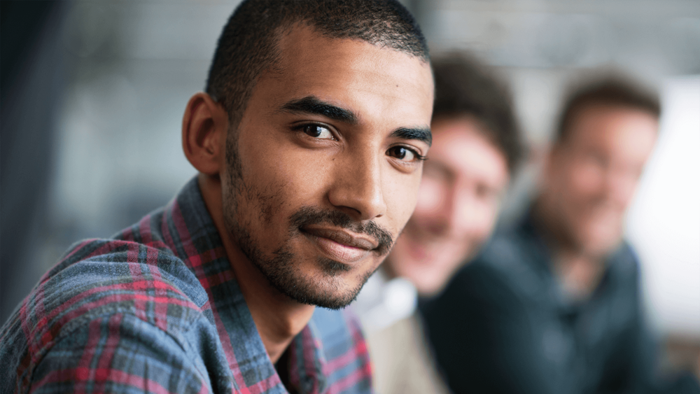 Young Man Attending Support Group Meeting