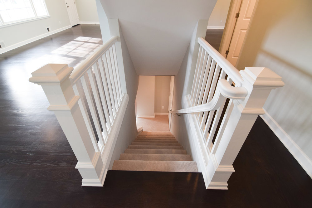Monarch Homes | The House Next Door | Basement Stairs - After