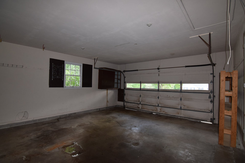 Monarch Homes | The House Next Door | Garage - Before