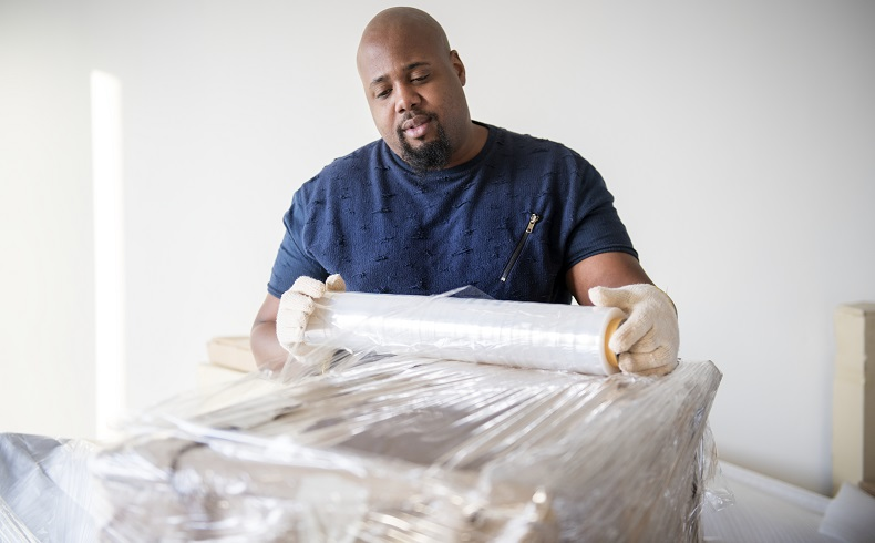Furniture Wrapping - To ensure your belongings stay safe during loading, unloading, and transport, we offer a furniture wrapping service that includes stretch wrap, moving blankets, and tape to ensure your belongings are in the same condition after the move as they were in before it.