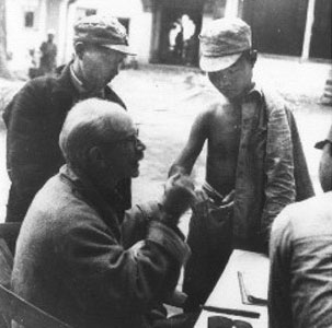 Dr. Bethune treating Chinese soldiers and villagers.