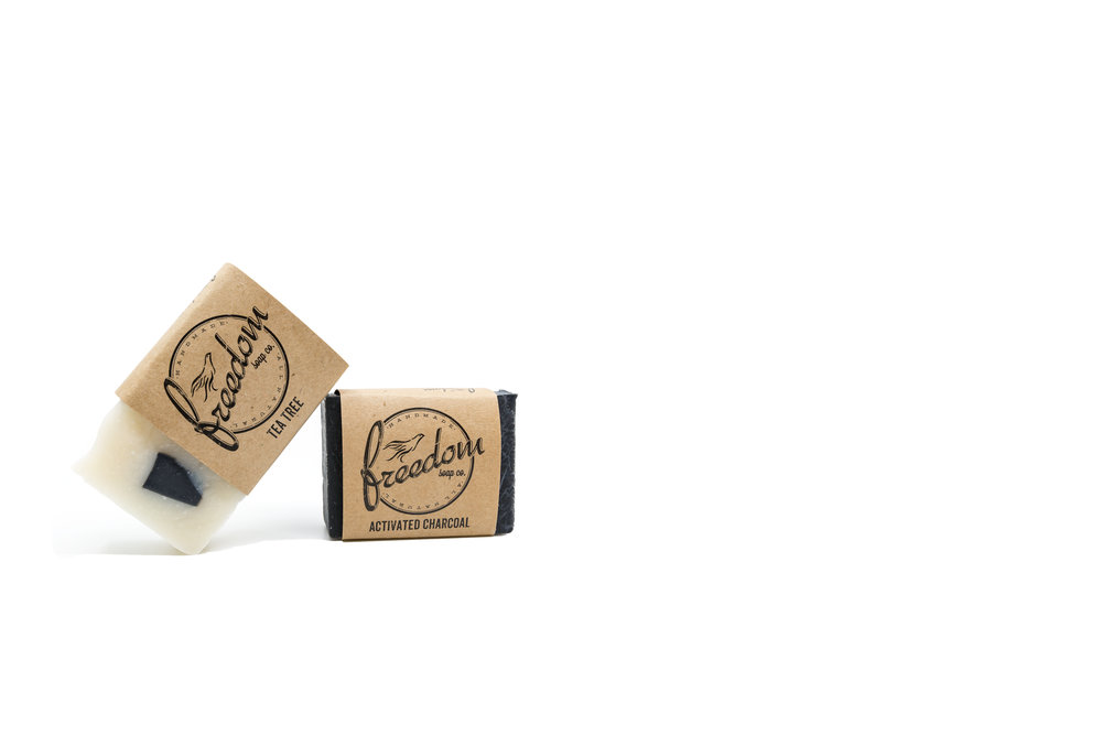 Product photography created for Freedom Soap Company featuring their all natural Tea Tree and Activated Charcoal soaps.