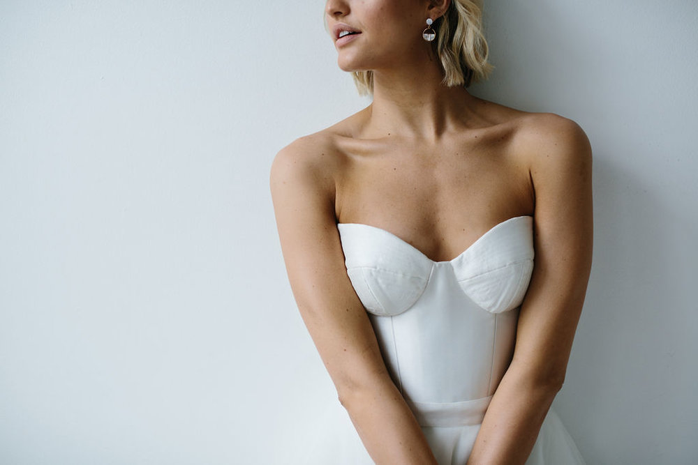 Modern Bridal Earrings with Shell inside Gold Hoops on natural tan blonde bride in Strapless sweetheart wedding dress for Amelie George Jewellery Campaign