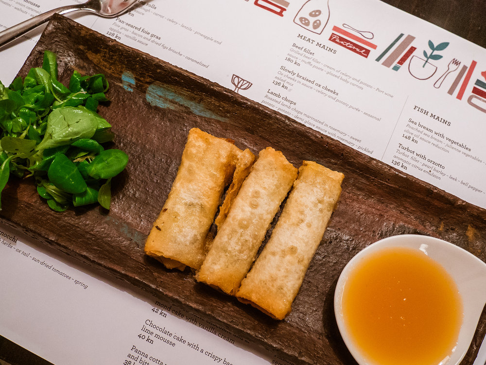 fried spring rolls and a pineapple based sauce
