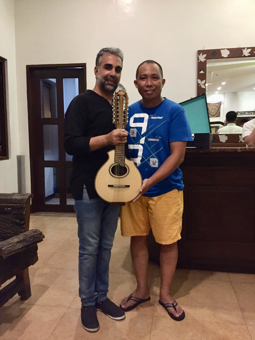 Jacob receiving the present from the instrument maker Jay Sarita