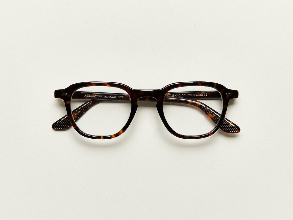 MOSCOT- Billik Opticals   £245   COLOUR  Tortoise   SIZE  50  There's nothing cheap about this new MOSCOT Original frame. In fact, with its LEMTOSH meets MORRIS-like frame shape, you're practically getting two frames in one! A tad bit more square, and with sharper edges, The BILLIK also features paddle temples with grips that really pay off.  Features two dot rivets  Comfortable key hole nose bridge  Includes acetate nose pads  3-Barrel hinge  MOSCOT temple engravings
