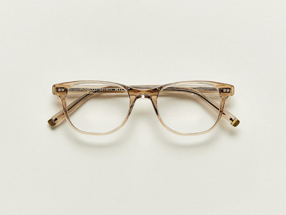 MOSCOT - Jesse Opticals   £245   COLOUR  Cinnamon   SIZE  50  A little bit square and a little bit round, The JESSE fits most faces effortlessly – so effortlessly you'll feel like you're Putting on your favorite pair of jeans... only on your face.  Handcrafted using Italian acetate featuring unique patterns distinctive to each frame  Features two dot rivets  Comfortable saddle nose bridge  Includes acetate nose pads  3-Barrel hinge  MOSCOT temple engravings  Signature brass temple tips for MOSCOT SPIRIT frames