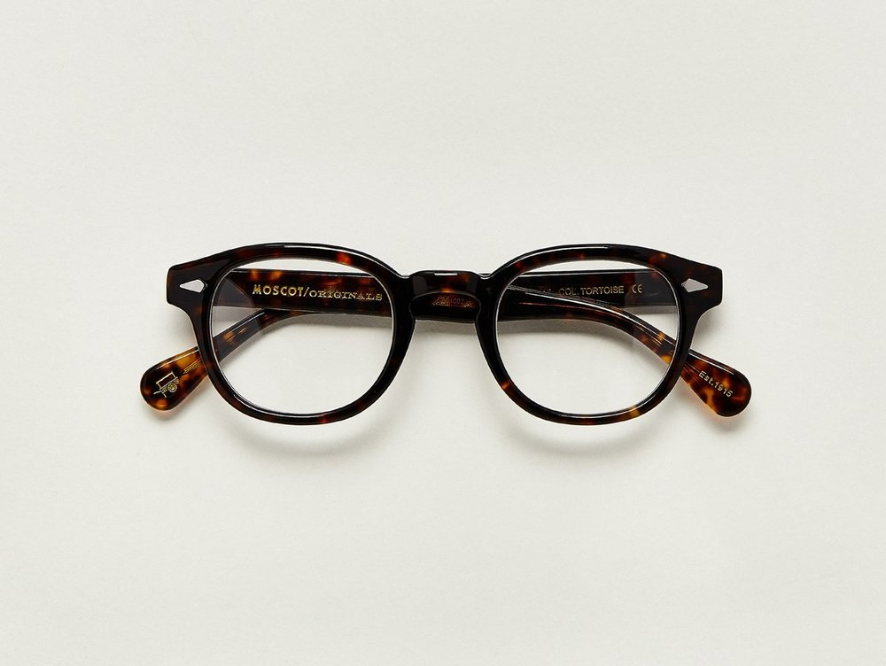MOSCOT - Lemtosh Opticals   £245   COLOUR  Tortoise   SIZE  46 & 49  This rounder number has served as the calling card for generations of creative, thoughtful, free-spirited intellectuals and artistes – from James Dean to Johnny Depp.  Handcrafted using Italian acetate featuring unique patterns distinctive to each frame  Features diamond rivets  Comfortable key hole nose bridge  Includes acetate nose pads  7-Barrel hinge  MOSCOT temple engravings  Signature acetate tips