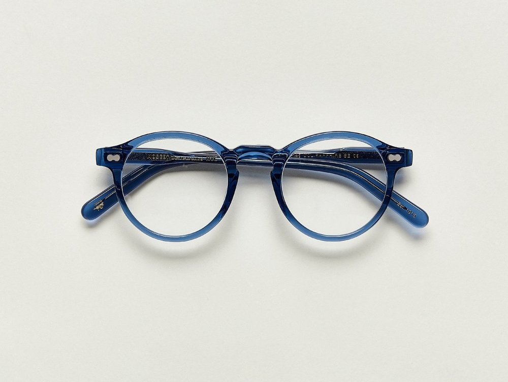 MOSCOT - Militzen Opticals    £245    COLOUR  Sapphire   SIZE  46  The round, full-vue MILTZEN, first introduced in the 1930s, is eponymously named for our Uncle Heshy, who inexplicably everyone called Uncle Miltzen. And it stuck. So there you go, world... The MILTZEN.  Handcrafted using Italian acetate  Features adjoined dot rivets  Comfortable key hole nose bridge  Includes acetate nose pads  3-Barrel hinge  MOSCOT temple engravings