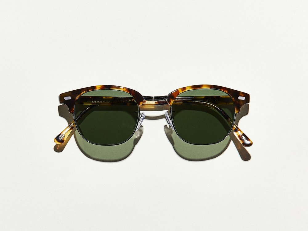 MOSCOT - Yukel Sunglasses   £265   COLOUR  Havana/Gunmetal   SIZE  51  Whether you're blazing trails, breaking rules, or changing games, these classic frames, reminiscent of Malcolm X's, will help you make a statement political or otherwise.    Handcrafted using a combination of metal and Italian acetate featuring unique patterns distinctive to each frame  Features dash rivets  Comfortable saddle nose bridge  Includes silicone nose pads  3-Barrel hinge  Features real glass lenses in G-15