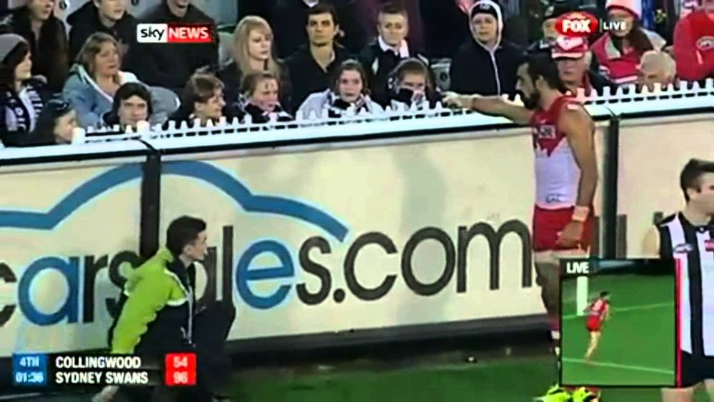 "Adam Goodes pointing out a girl who had called him an ""ape""."