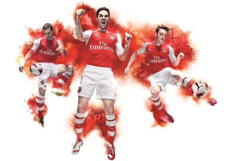 abe9dff8796 PUMA launch Arsenal 2014-15 Home Kit Podolski Arteta Ozil Action HR (1000 x  713).jpg