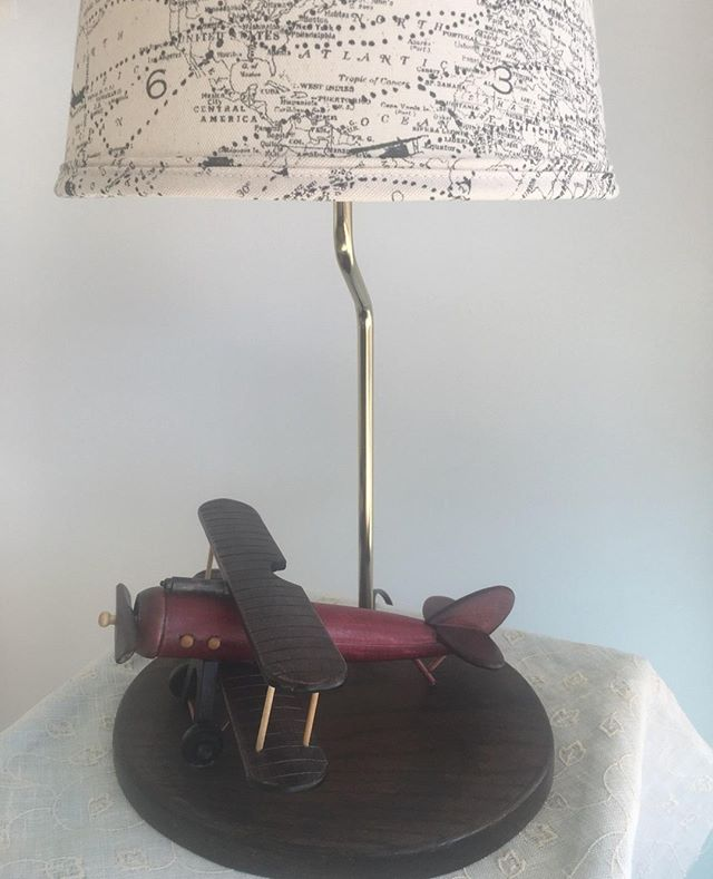 Up, up and away! We're excited to share this week some of the fabulous customs we've made for customers who are gifting lamps. Here's the first! A wooden airplane with a fabric shade showing airline routes. Clever, right?! #customlamp #customshade #airplanelamp #downtownlufkintx