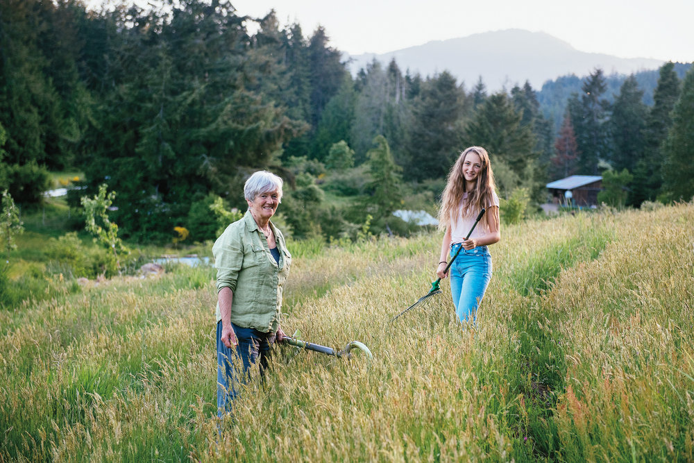 Lisa and Atisha working in the hillside permaculture garden.