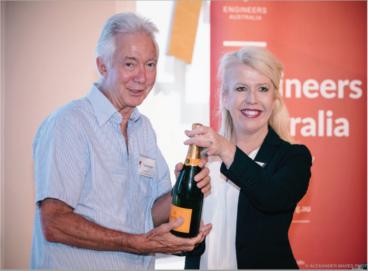 Gary Bullock MD of Protectiflex parent company receiving a bottle of champagne at a recent Engineers Australia event.