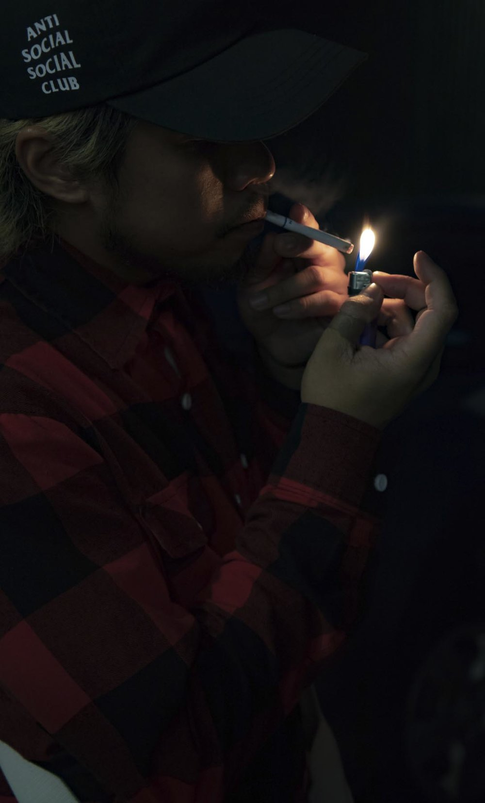 Young Asian man smoking.jpg