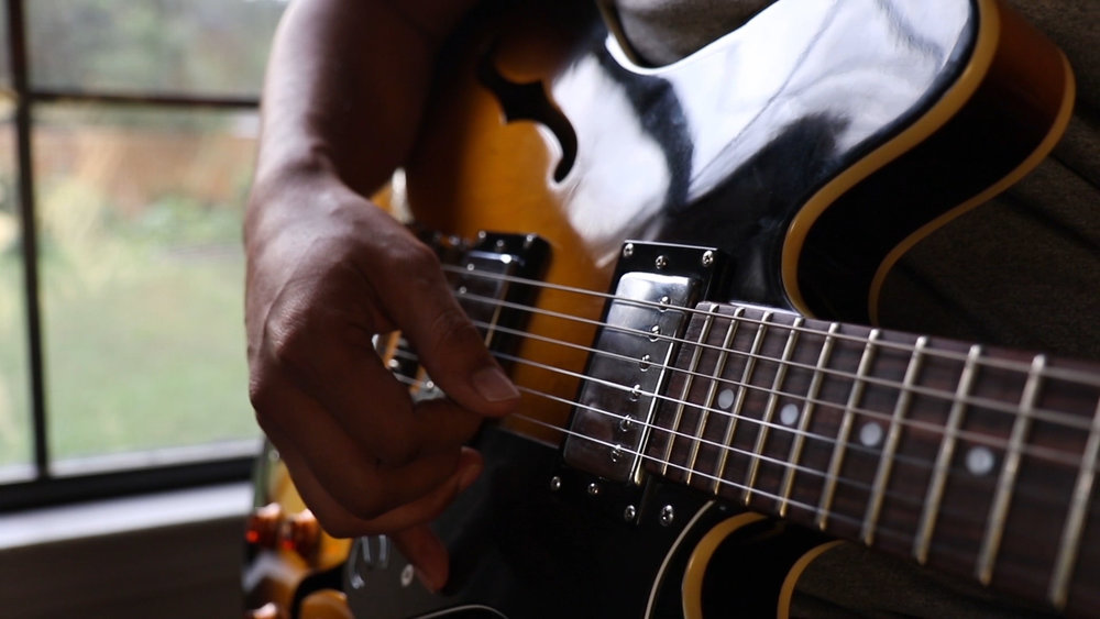 guitarist playing by natural light.jpg