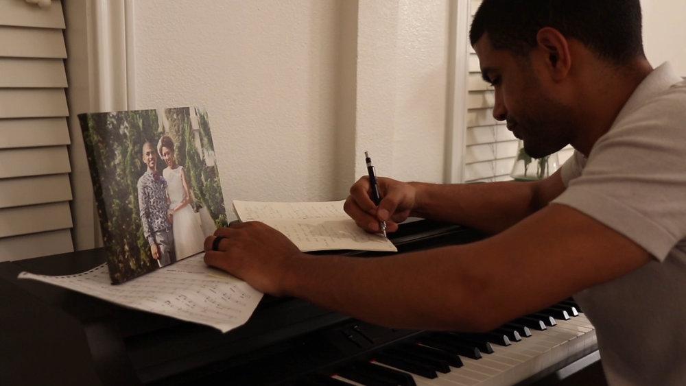 musician at piano writing dallas music video.jpg