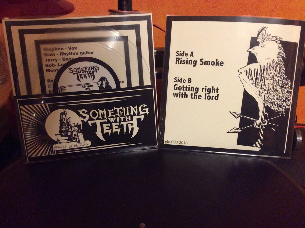 Longview doom metal band Something With Teeth sold all theses before i could even put one on my site.
