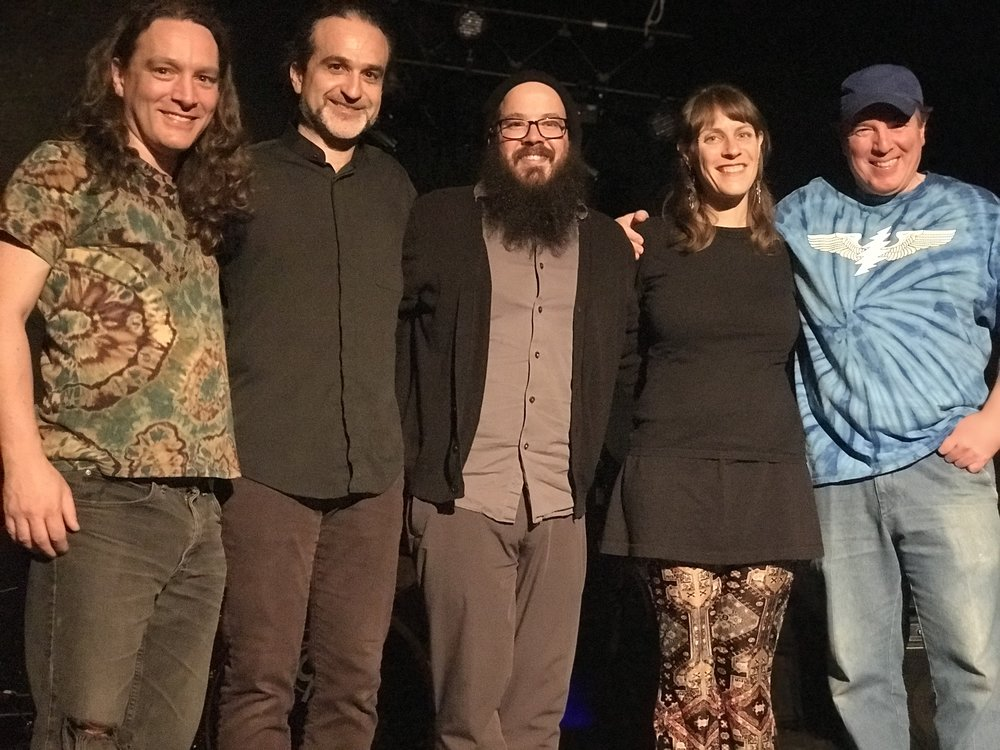 L to R: Brian O'Connell (e bass), Andy Bergmann (clarinet & bari sax), Dylan Jack (drums), Rachel Koppelman (accordion), Larry Mancini (guitar). 3/5 of Minouchka wore black; 2/5 wore tie-dye.  That about sums it up!