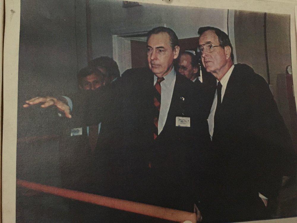 Robert E. Berry Guides President George H. W. Bush during a tour of SSL Headquarters in Palo Alto, CA.jpg