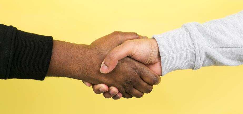 hand-shake-on-yellow-crop.jpg