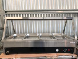 BakBar 4 Pan Bain Marie – Used   $1,200.00 + GST   10 Amp – Wet or Dry Operation – Glass Side Panels Only – Heat Lamps – *Pans Included*  Dimensions : 1400W x 650D