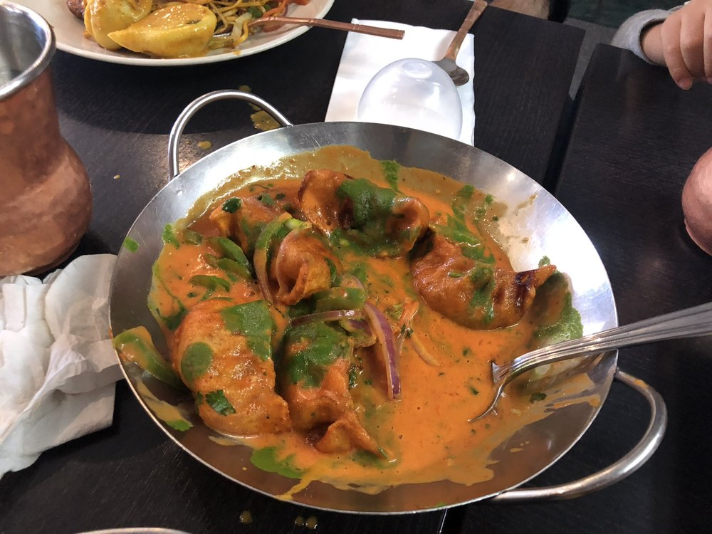 Jhol momo- curry with gravy dumpling. Extra spicy! Love Himalayan Kitchen