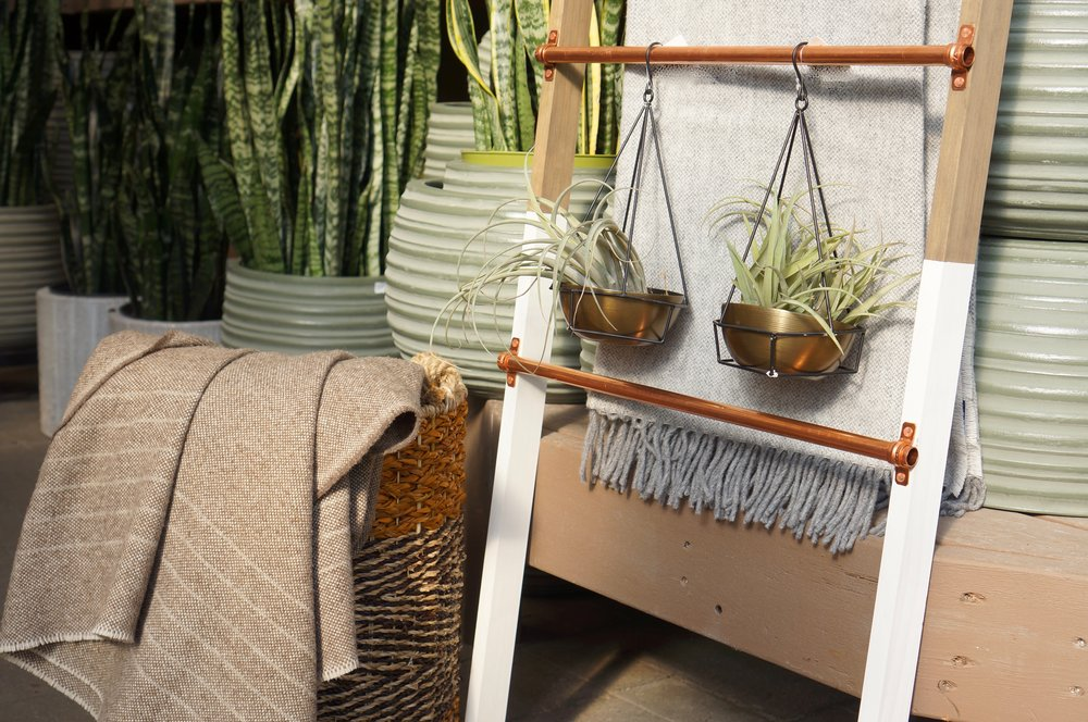 plant blanket ladder and blankets in basket