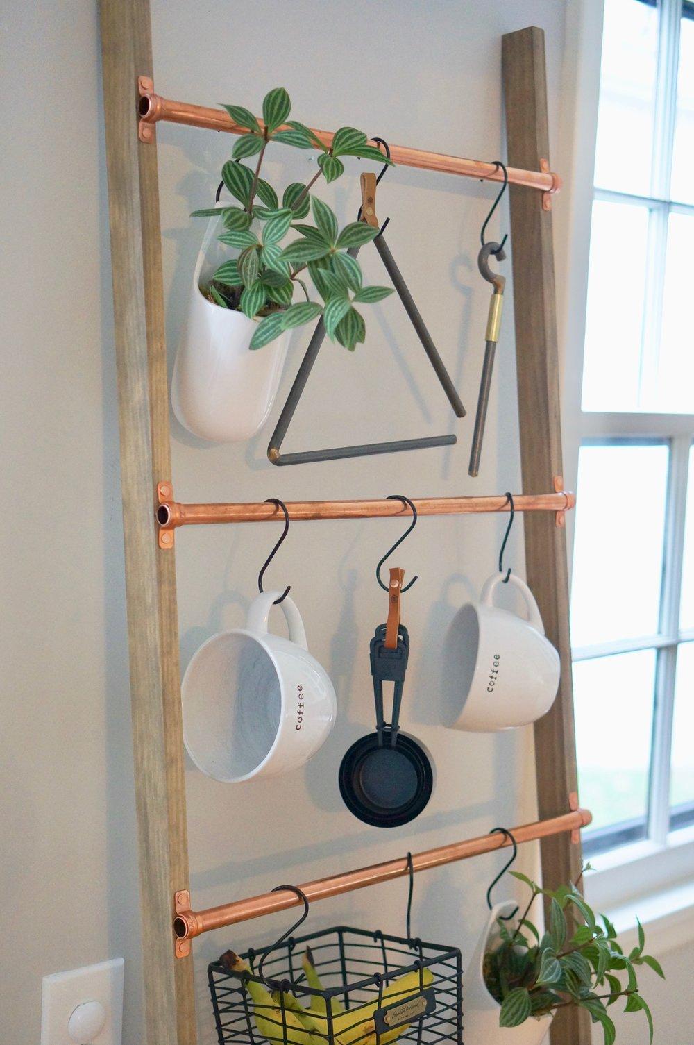 kitchen items organized on a blanket ladder