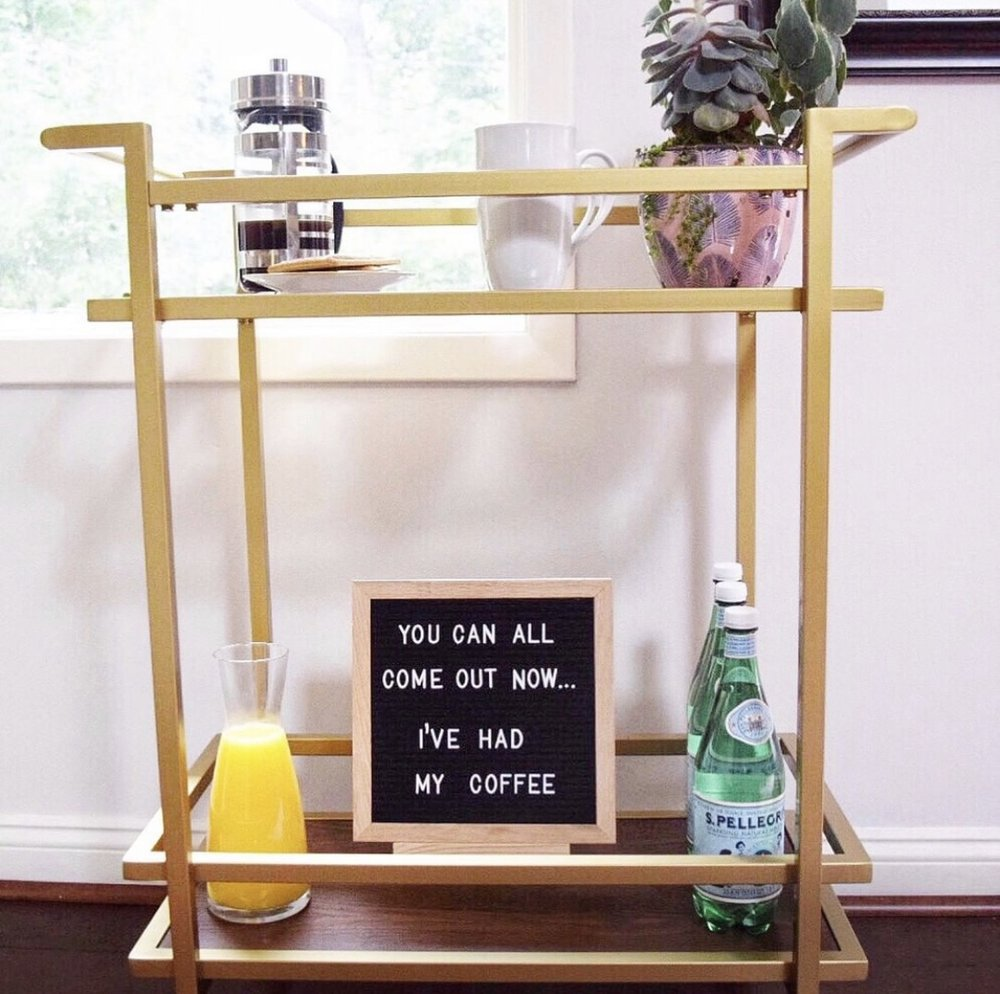 coffee bar cart with letter board, coffee, and orange juice