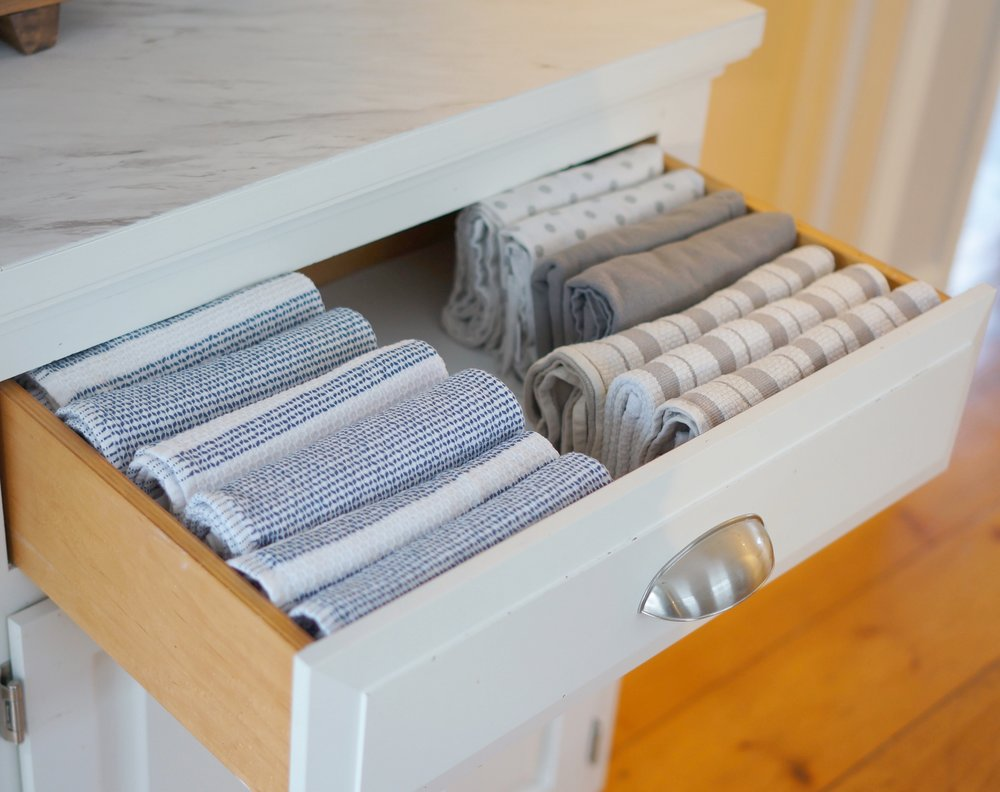 organized dish towels in a drawer