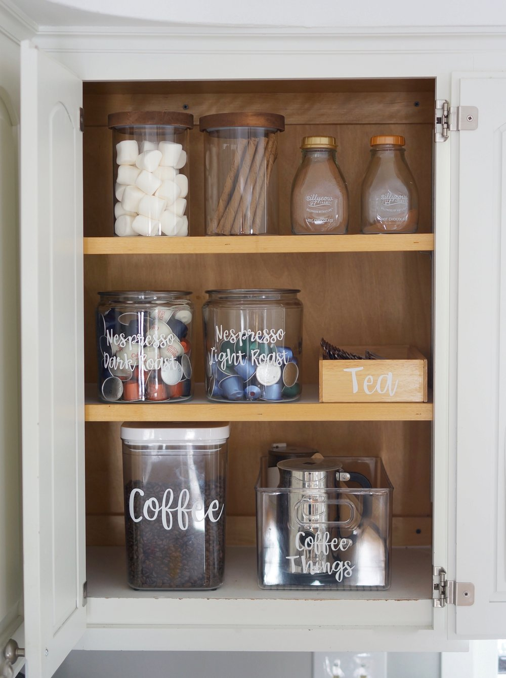 baking cabinet with hot coco and coffee bar